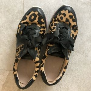 Kate Spade sneakers in leopard and black leather.